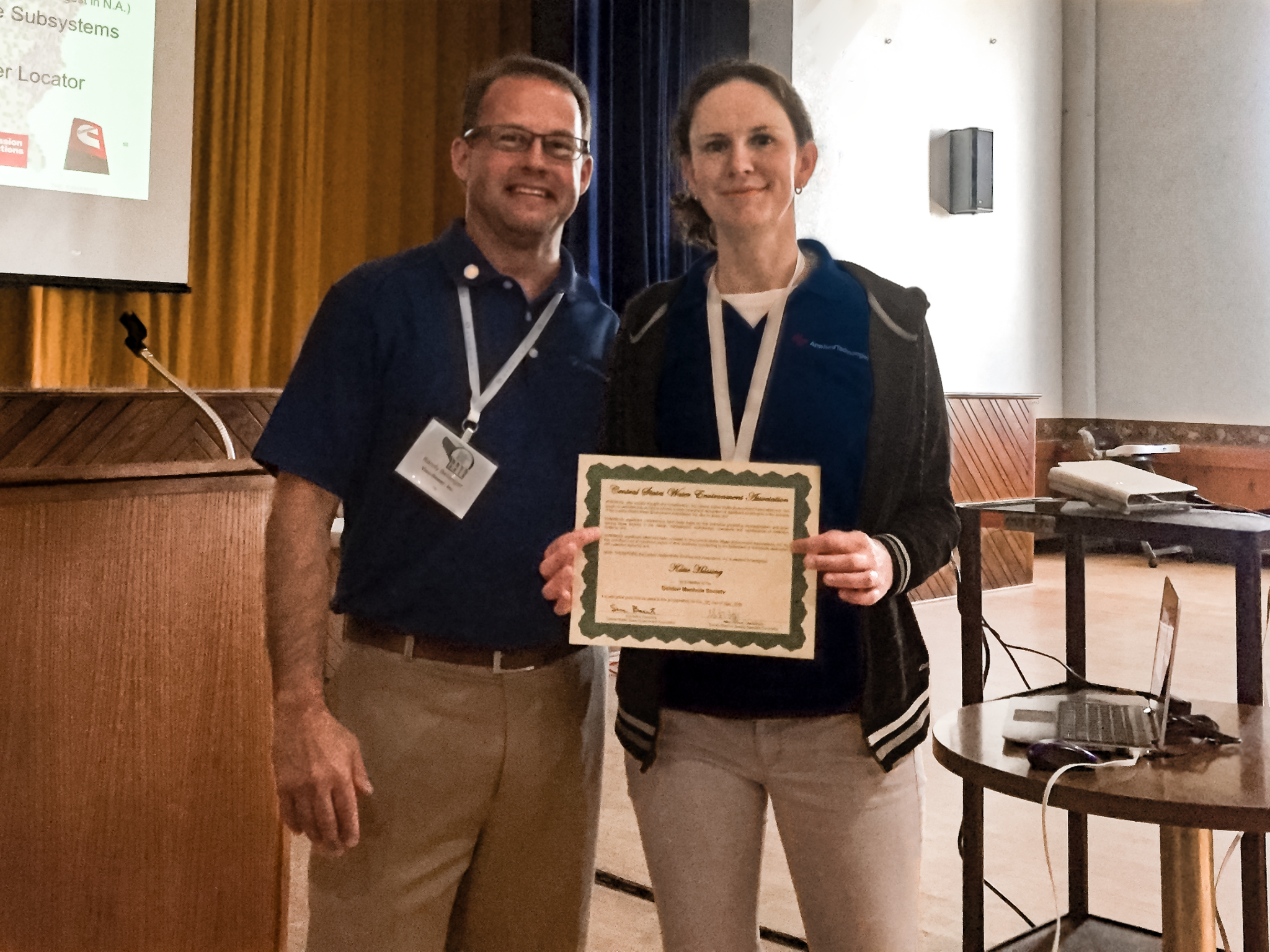 Katie Hassing receiving the Golden Manhole Society Award